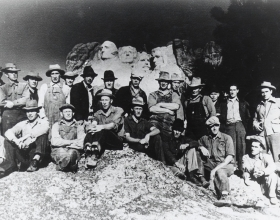 Workers Sitting In Front Of The Mount Rushmore National Memorial